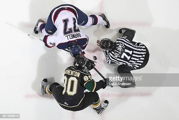 Alex Formenton of the London Knights takes a faceoff against Jesse Barwell of the Saginaw Spirit during an OHL game at Budweiser Gardens on January...