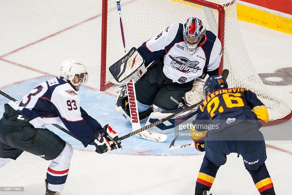 Alex Fotinos #39 of the Windsor Spitfires makes a save against Quentin Maksimovich #26 of the Erie Otters on September 26, 2014 at the WFCU Centre in Windsor, Ontario, Canada.