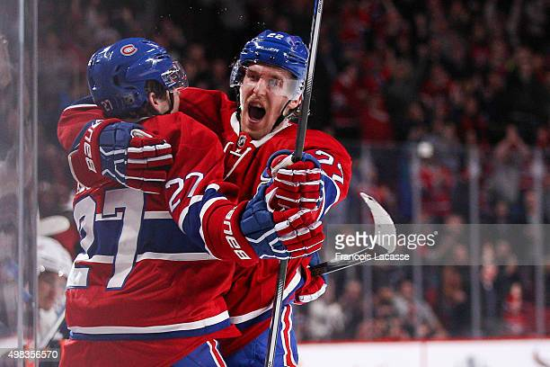 Alex Galchenyuk and Dale Weise of the Montreal Canadiens celebrate a goal in the NHL game against the New York Islanders at the Bell Centre on...