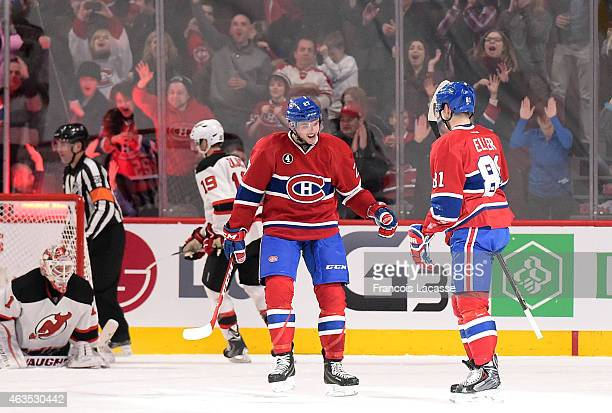 Alex Galchenyuk and Lars Eller of the Montreal Canadiens celebrate after scoring a goal against the New Jersey Devils in the NHL game at the Bell...