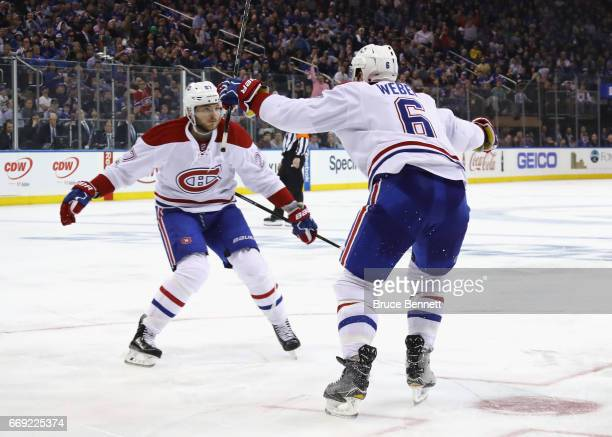 Alex Galchenyuk and Shea Weber of the Montreal Canadiens celebrate Weber's third period goal against the New York Rangers in Game Three of the...
