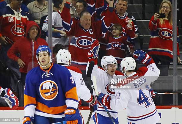 Alex Galchenyuk Brendan Gallagher and Paul Byron of the Montreal Canadiens celebrate a second period goal by Byron against the New York Islanders at...