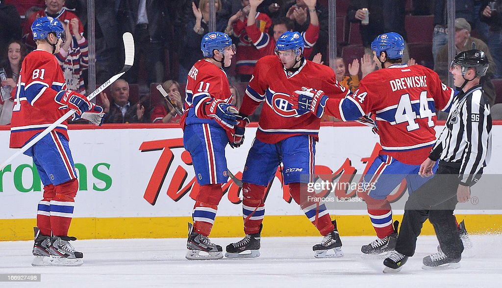 <a gi-track='captionPersonalityLinkClicked' href=/galleries/search?phrase=Alex+Galchenyuk&family=editorial&specificpeople=7419137 ng-click='$event.stopPropagation()'>Alex Galchenyuk</a> #27, <a gi-track='captionPersonalityLinkClicked' href=/galleries/search?phrase=Brendan+Gallagher&family=editorial&specificpeople=3704208 ng-click='$event.stopPropagation()'>Brendan Gallagher</a> #11, <a gi-track='captionPersonalityLinkClicked' href=/galleries/search?phrase=Lars+Eller&family=editorial&specificpeople=4324947 ng-click='$event.stopPropagation()'>Lars Eller</a> #81 and <a gi-track='captionPersonalityLinkClicked' href=/galleries/search?phrase=Davis+Drewiske&family=editorial&specificpeople=696711 ng-click='$event.stopPropagation()'>Davis Drewiske</a> #44 of the Montreal Canadiens celebrate a goal in the second period of NHL action against the Tampa Bay Lightning on April 18, 2013 at the Bell Centre in Montreal, Quebec, Canada.