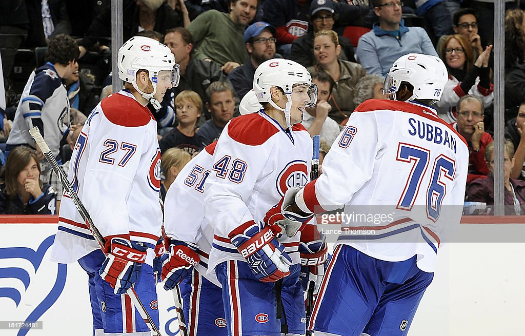 <a gi-track='captionPersonalityLinkClicked' href=/galleries/search?phrase=Alex+Galchenyuk&family=editorial&specificpeople=7419137 ng-click='$event.stopPropagation()'>Alex Galchenyuk</a> #27, <a gi-track='captionPersonalityLinkClicked' href=/galleries/search?phrase=David+Desharnais&family=editorial&specificpeople=4084305 ng-click='$event.stopPropagation()'>David Desharnais</a> #51, <a gi-track='captionPersonalityLinkClicked' href=/galleries/search?phrase=Daniel+Briere&family=editorial&specificpeople=201624 ng-click='$event.stopPropagation()'>Daniel Briere</a> #48 and <a gi-track='captionPersonalityLinkClicked' href=/galleries/search?phrase=P.K.+Subban&family=editorial&specificpeople=714418 ng-click='$event.stopPropagation()'>P.K. Subban</a> #76 of the Montreal Canadiens celebrate a third period goal against the Winnipeg Jets at the MTS Centre on October 15, 2013 in Winnipeg, Manitoba, Canada.