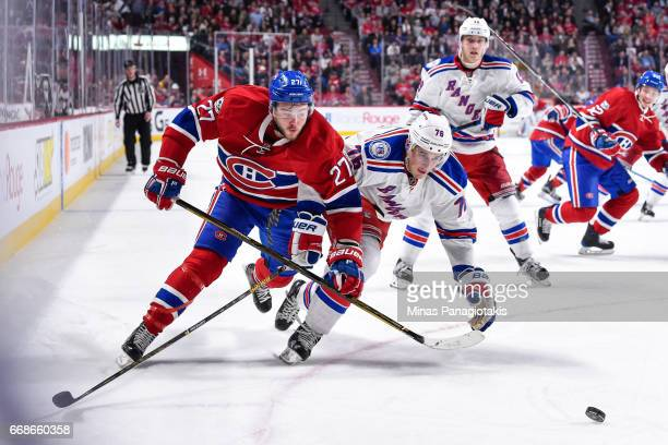 Alex Galchenyuk of the Montreal Canadiens and Brady Skjei of the New York Rangers chase after the puck in Game Two of the Eastern Conference First...