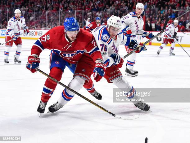 Alex Galchenyuk of the Montreal Canadiens and Brady Skjei of the New York Rangers skate after the puck in Game Two of the Eastern Conference First...