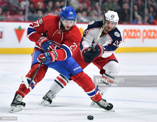 Alex Galchenyuk of the Montreal Canadiens and Brandon Saad of the Columbus Blue Jackets fight for the puck in the NHL game at the Bell Centre on...