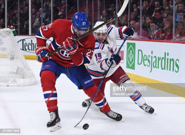 Alex Galchenyuk of the Montreal Canadiens and Jesper Fast of the New York Rangers fight for the puck in Game Five of the Eastern Conference...