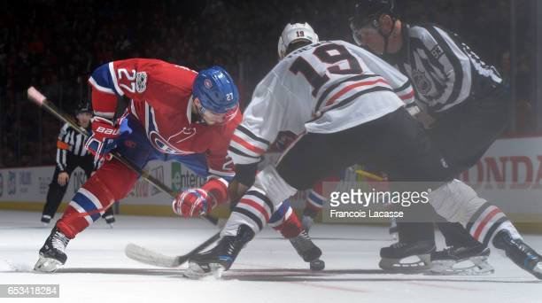 Alex Galchenyuk of the Montreal Canadiens and Jonathan Toews of the Chicago Blackhawks face off in the NHL game at the Bell Centre on March 14 2017...
