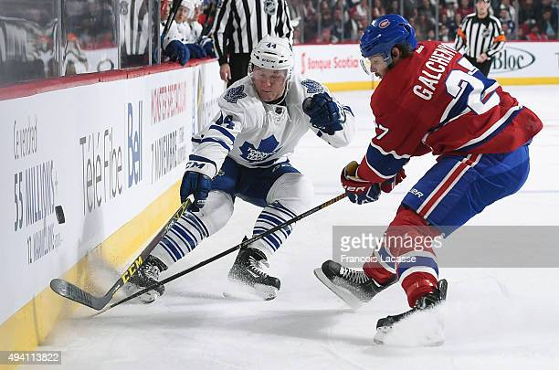 Alex Galchenyuk of the Montreal Canadiens and Morgan Rielly of the Toronto Maple Leafs fight for the puckin the NHL game at the Bell Centre on...