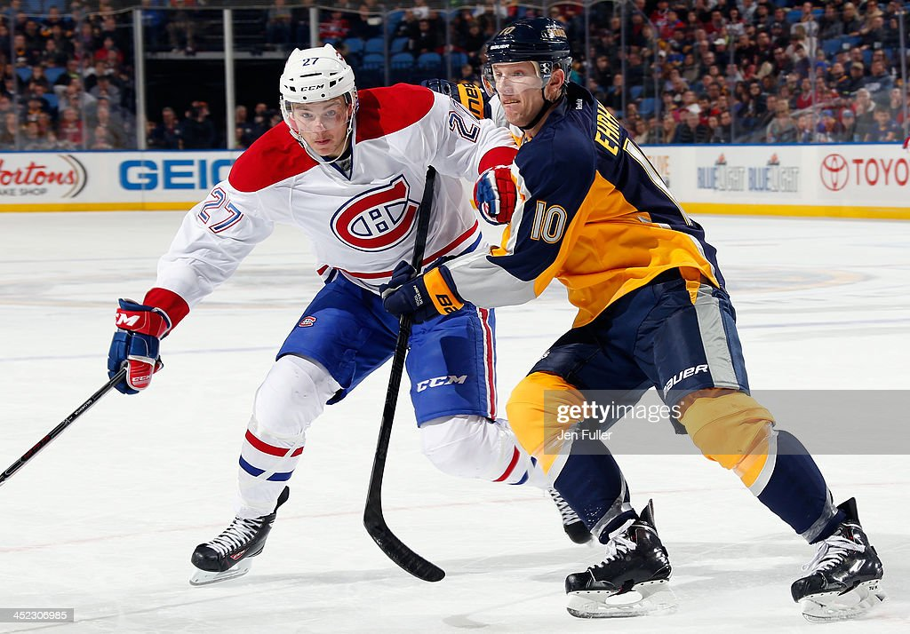 <a gi-track='captionPersonalityLinkClicked' href=/galleries/search?phrase=Alex+Galchenyuk&family=editorial&specificpeople=7419137 ng-click='$event.stopPropagation()'>Alex Galchenyuk</a> #27 of the Montreal Canadiens battles with <a gi-track='captionPersonalityLinkClicked' href=/galleries/search?phrase=Christian+Ehrhoff&family=editorial&specificpeople=214788 ng-click='$event.stopPropagation()'>Christian Ehrhoff</a> #10 of the Buffalo Sabres at First Niagara Center on November 27, 2013 in Buffalo, New York. Montreal defeated Buffalo 3-1.