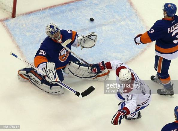 Alex Galchenyuk of the Montreal Canadiens celebrates a second period goal by PK Subban against Evgeni Nabokov of the New York Islanders at the Nassau...