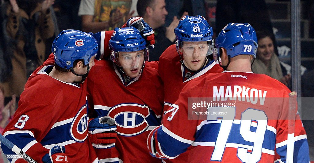 Alex Galchenyuk #27 of the Montreal Canadiens celebrates after scoring a goal against the Minnesota Wild, with teammates Brandon Prust #8, Lars Eller #81 and Andrei Markov #79 during the NHL game on November 19, 2013 at the Bell Centre in Montreal, Quebec, Canada.