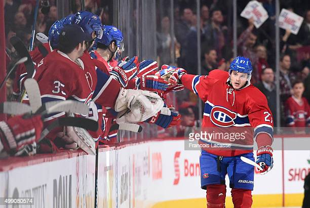 Alex Galchenyuk of the Montreal Canadiens celebrates after scoring a goal against the New Jersey Devils in the NHL game at the Bell Centre on...