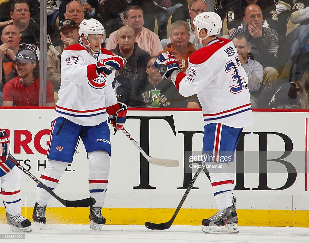 <a gi-track='captionPersonalityLinkClicked' href=/galleries/search?phrase=Alex+Galchenyuk&family=editorial&specificpeople=7419137 ng-click='$event.stopPropagation()'>Alex Galchenyuk</a> #27 of the Montreal Canadiens celebrates his goal with <a gi-track='captionPersonalityLinkClicked' href=/galleries/search?phrase=Travis+Moen&family=editorial&specificpeople=208110 ng-click='$event.stopPropagation()'>Travis Moen</a> #32 during the second period against the Pittsburgh Penguins on April17, 2013 at Consol Energy Center in Pittsburgh, Pennsylvania.