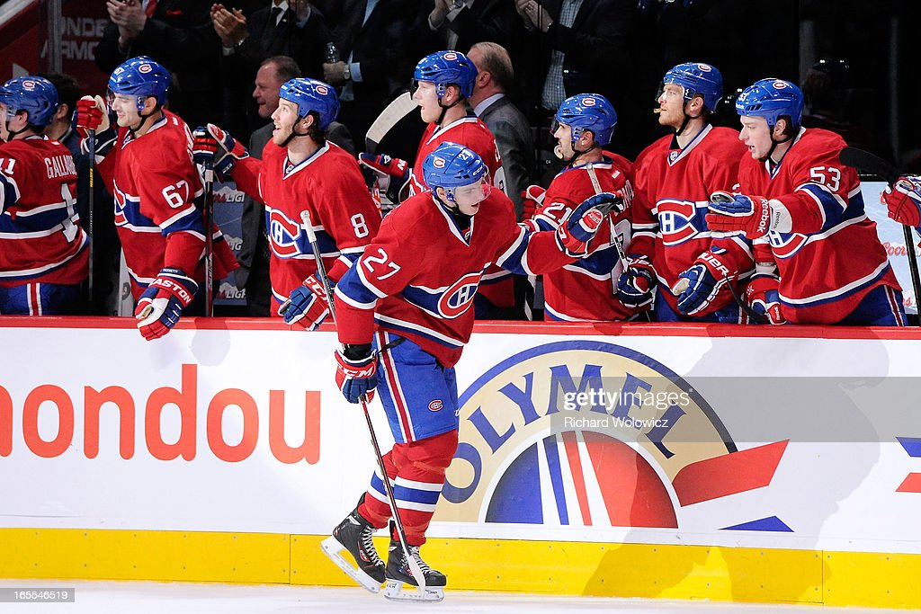 <a gi-track='captionPersonalityLinkClicked' href=/galleries/search?phrase=Alex+Galchenyuk&family=editorial&specificpeople=7419137 ng-click='$event.stopPropagation()'>Alex Galchenyuk</a> #27 of the Montreal Canadiens celebrates his third-period goal with teammates during the NHL game against the Winnipeg Jets at the Bell Centre on April 4, 2013 in Montreal, Quebec, Canada. The Canadiens defeated the Jets 4-1.