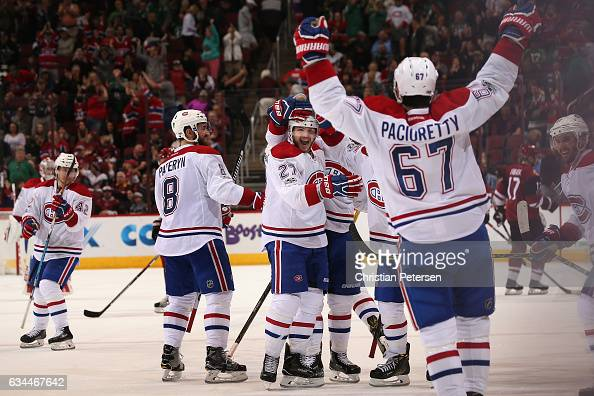 Alex Galchenyuk of the Montreal Canadiens celebrates with Greg Pateryn Max Pacioretty and Torrey Mitchell after scoring the game winning goal against...