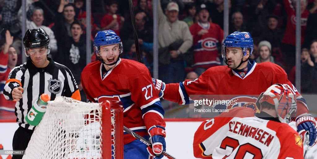 <a gi-track='captionPersonalityLinkClicked' href=/galleries/search?phrase=Alex+Galchenyuk&family=editorial&specificpeople=7419137 ng-click='$event.stopPropagation()'>Alex Galchenyuk</a> #27 of the Montreal Canadiens, celebrates with teammate <a gi-track='captionPersonalityLinkClicked' href=/galleries/search?phrase=Tomas+Plekanec&family=editorial&specificpeople=620244 ng-click='$event.stopPropagation()'>Tomas Plekanec</a> #14 after scoring a goal against the Florida Panthers during the NHL game on December 15, 2013 at the Bell Centre in Montreal, Quebec, Canada.