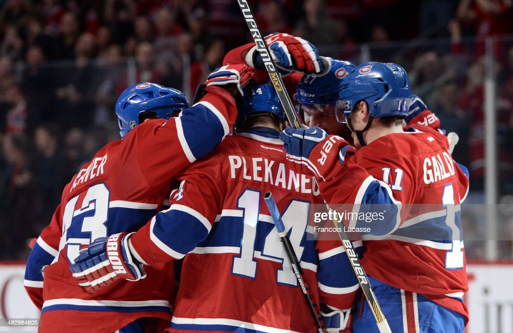 <a gi-track='captionPersonalityLinkClicked' href=/galleries/search?phrase=Alex+Galchenyuk&family=editorial&specificpeople=7419137 ng-click='$event.stopPropagation()'>Alex Galchenyuk</a> #27 of the Montreal Canadiens celebrates with teammates <a gi-track='captionPersonalityLinkClicked' href=/galleries/search?phrase=Tomas+Plekanec&family=editorial&specificpeople=620244 ng-click='$event.stopPropagation()'>Tomas Plekanec</a> #14, Mike Weaver #43 and <a gi-track='captionPersonalityLinkClicked' href=/galleries/search?phrase=Brendan+Gallagher&family=editorial&specificpeople=3704208 ng-click='$event.stopPropagation()'>Brendan Gallagher</a> #11 after scoring the winning goal against of the Detroit Red Wings during the NHL game on April 5, 2014 at the Bell Centre in Montreal, Quebec, Canada.