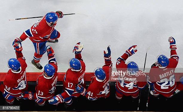 Alex Galchenyuk of the Montreal Canadiens celebrates with the bench after scoring a goal against the Florida Panthers in the NHL game at the Bell...