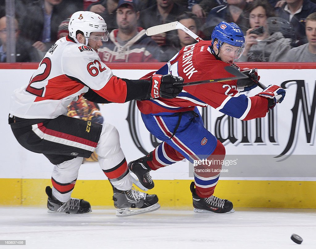 <a gi-track='captionPersonalityLinkClicked' href=/galleries/search?phrase=Alex+Galchenyuk&family=editorial&specificpeople=7419137 ng-click='$event.stopPropagation()'>Alex Galchenyuk</a> #27 of the Montreal Canadiens chases after the puck with Eric Gryba #62 of the Ottawa Senators during the NHL game on March 13, 2013 at the Bell Centre in Montreal, Quebec, Canada.