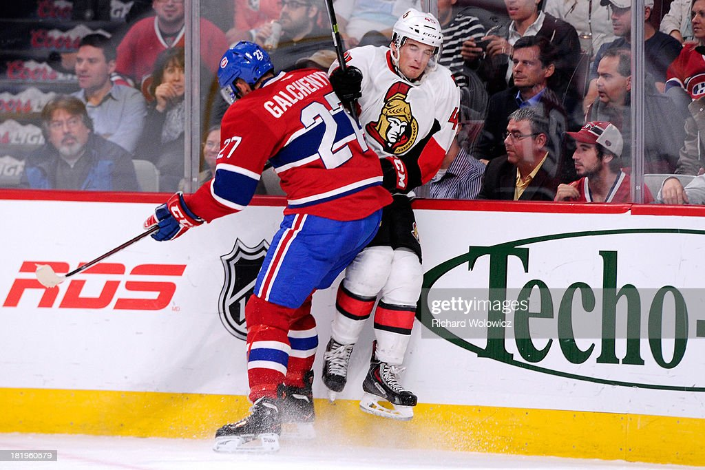 <a gi-track='captionPersonalityLinkClicked' href=/galleries/search?phrase=Alex+Galchenyuk&family=editorial&specificpeople=7419137 ng-click='$event.stopPropagation()'>Alex Galchenyuk</a> #27 of the Montreal Canadiens checks Chris Wideman #45 of the Ottawa Senators during an NHL preseason game at the Bell Centre on September 26, 2013 in Montreal, Quebec, Canada.