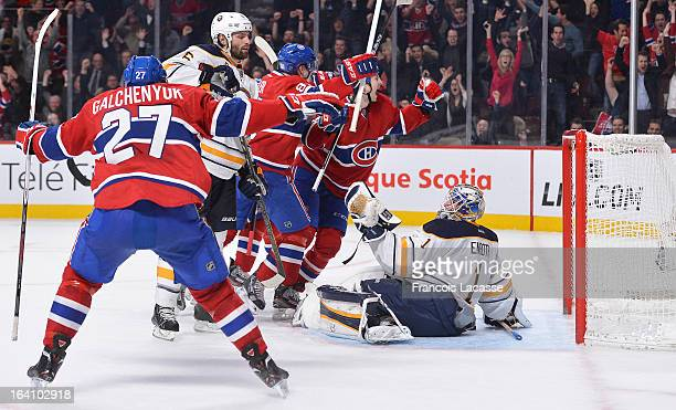 Alex Galchenyuk of the Montreal Canadiens congratulates Colby Armstrong on the tying goal during the NHL game against the Buffalo Sabres on March 19...