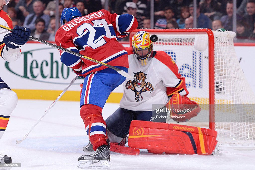 Alex Galchenyuk #27 of the Montreal Canadiens deflects the puck past Scott Clemmensen #30 of the Florida Panthers to score his first career NHL goal during the game at the Bell Centre on January 22, 2013 in Montreal, Quebec, Canada.