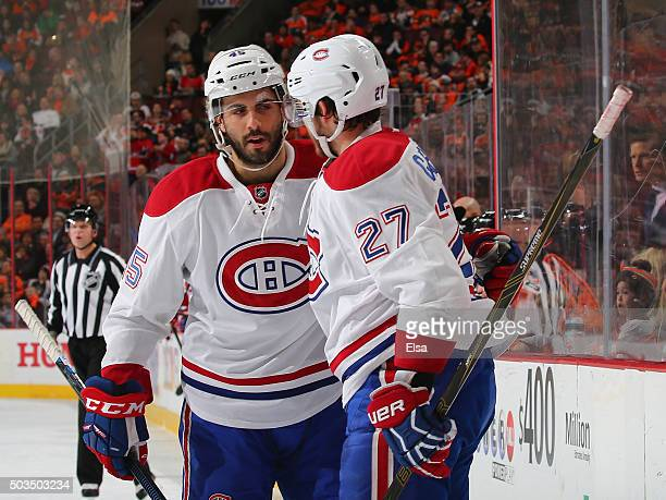 Alex Galchenyuk of the Montreal Canadiens is congratulated by teammate Mark Barberio after he scored a goal in the first period against the...