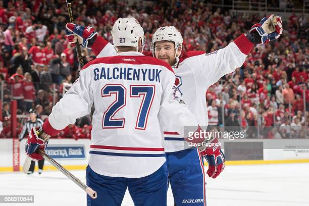 Alex Galchenyuk of the Montreal Canadiens is congratulated following his overtime goal by teammate Nikita Nesterov following an NHL game against the...