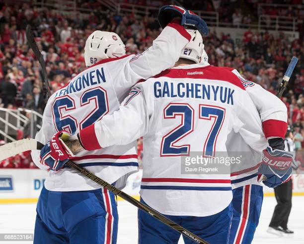 Alex Galchenyuk of the Montreal Canadiens is congratulated following his overtime goal by teammate Artturi Lehkonen following an NHL game against the...
