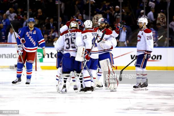 Alex Galchenyuk of the Montreal Canadiens is mobbed by his teammates after scoring the game winning overtime goal against the New York Rangers in...