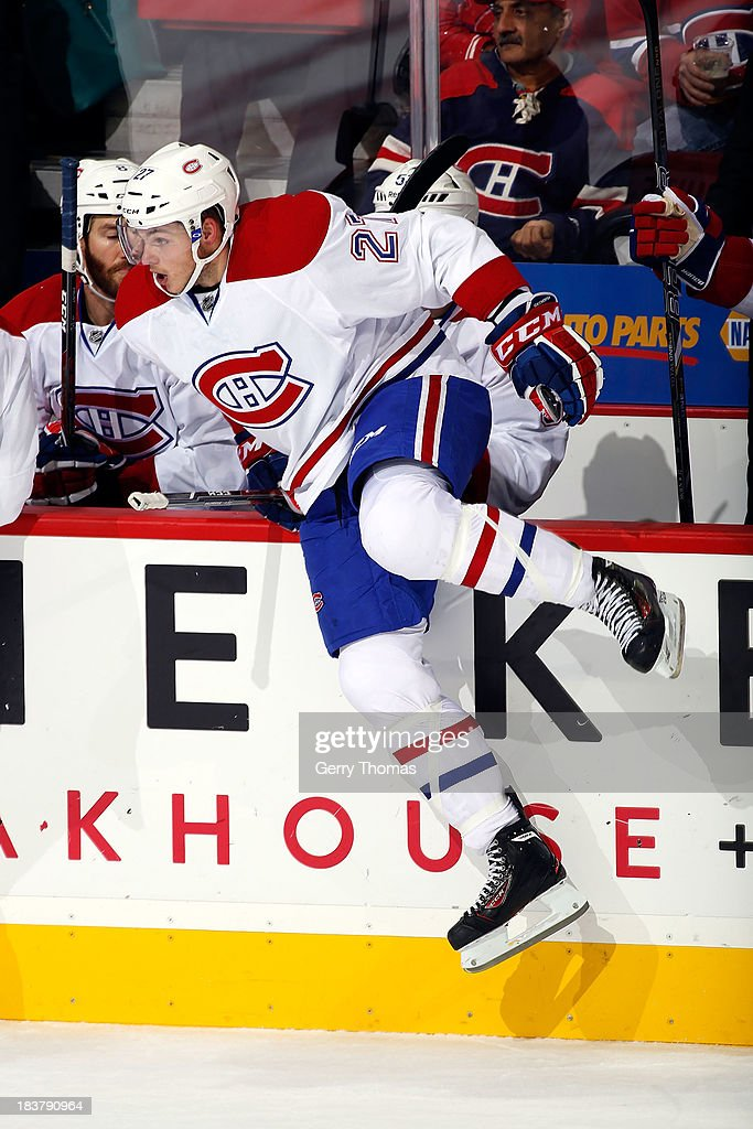 Alex Galchenyuk #27 of the Montreal Canadiens jumps over the boards for a shift against the Calgary Flames at Scotiabank Saddledome on October 9, 2013 in Calgary, Alberta, Canada.