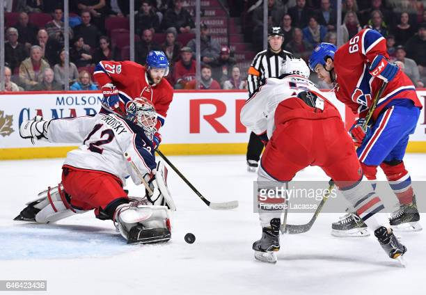 Alex Galchenyuk of the Montreal Canadiens misses the net against Sergei Bobrovsky of the Columbus Blue Jackets in the NHL game at the Bell Centre on...