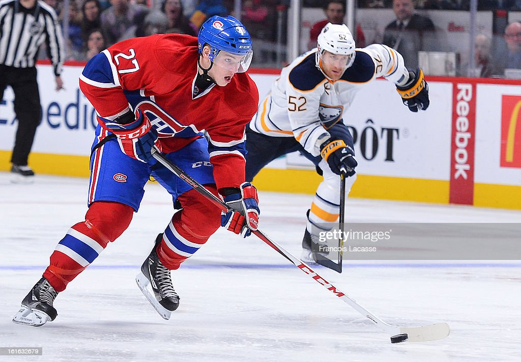 Alex Galchenyuk #27 of the Montreal Canadiens moves to the puck followed by Alexander Sulzer #52 of the Buffalo Sabres during the NHL game on February 2, 2013 at the Bell Centre in Montreal, Quebec, Canada.