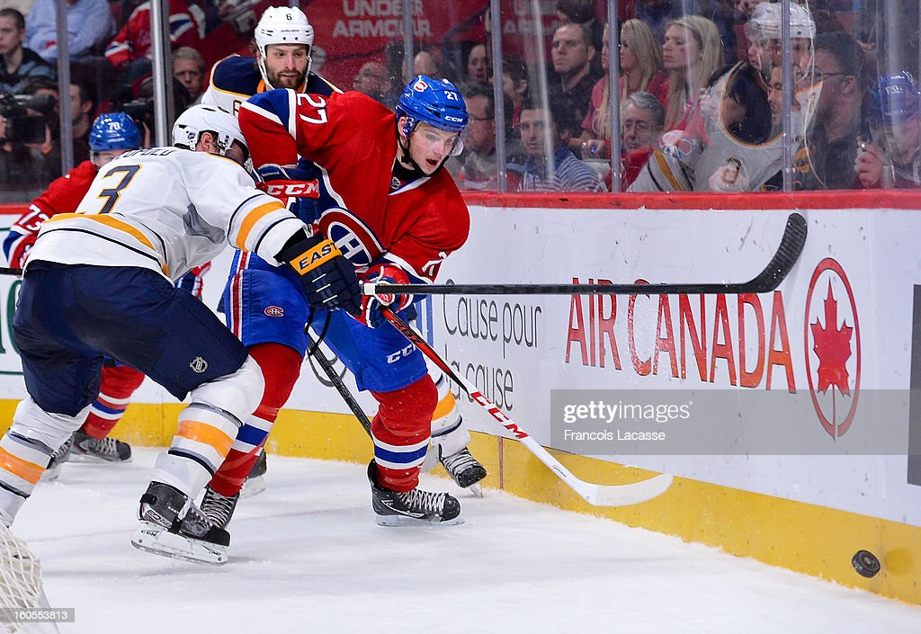 <a gi-track='captionPersonalityLinkClicked' href=/galleries/search?phrase=Alex+Galchenyuk&family=editorial&specificpeople=7419137 ng-click='$event.stopPropagation()'>Alex Galchenyuk</a> #27 of the Montreal Canadiens passes the puck behind the net of the Buffalo Sabres during the NHL game on February 2, 2013 at the Bell Centre in Montreal, Quebec, Canada.