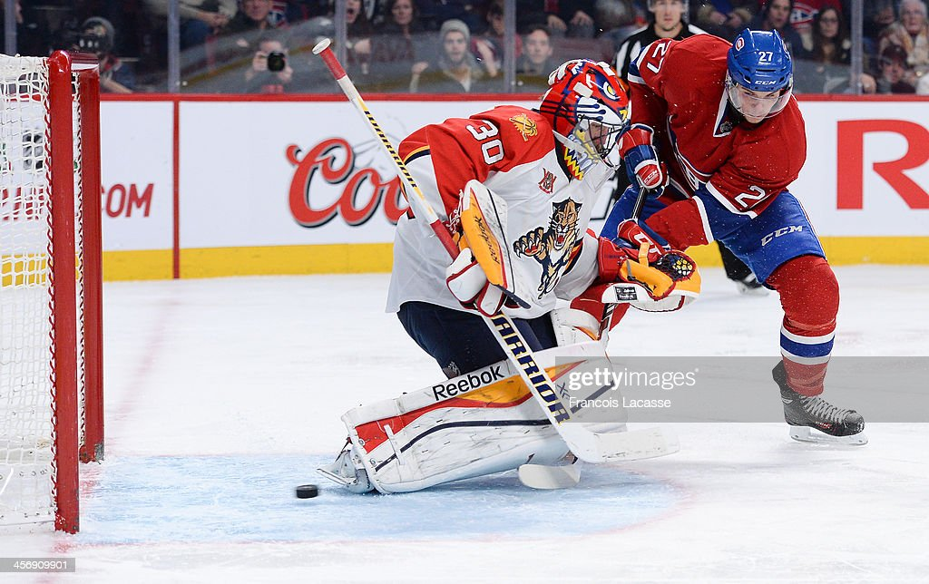 <a gi-track='captionPersonalityLinkClicked' href=/galleries/search?phrase=Alex+Galchenyuk&family=editorial&specificpeople=7419137 ng-click='$event.stopPropagation()'>Alex Galchenyuk</a> #27 of the Montreal Canadiens, scores a goal on goaltender <a gi-track='captionPersonalityLinkClicked' href=/galleries/search?phrase=Scott+Clemmensen&family=editorial&specificpeople=214674 ng-click='$event.stopPropagation()'>Scott Clemmensen</a> #30 of the Florida Panthers during the NHL game on December 15, 2013 at the Bell Centre in Montreal, Quebec, Canada.