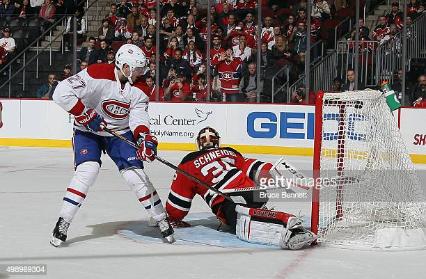 Alex Galchenyuk of the Montreal Canadiens scores a shootout goal against Cory Schneider of the New Jersey Devils at the Prudential Center on November...