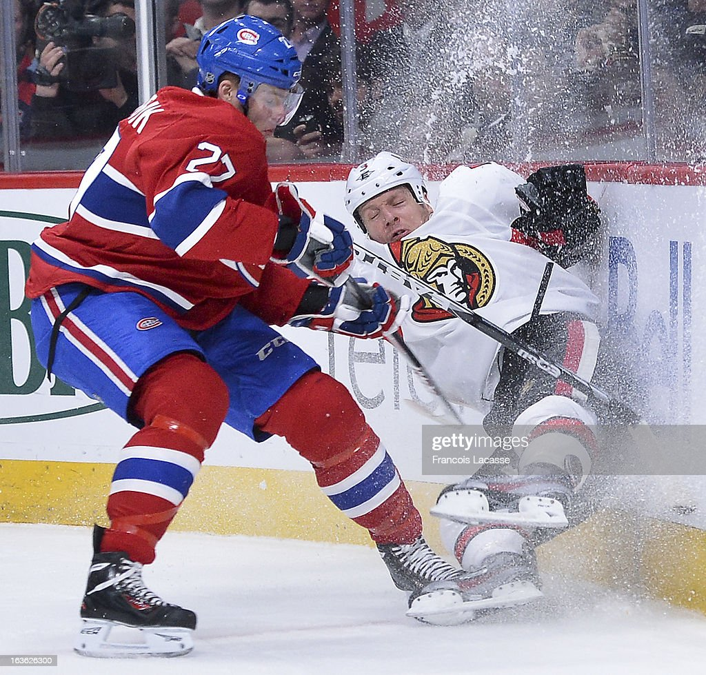 <a gi-track='captionPersonalityLinkClicked' href=/galleries/search?phrase=Alex+Galchenyuk&family=editorial&specificpeople=7419137 ng-click='$event.stopPropagation()'>Alex Galchenyuk</a> #27 of the Montreal Canadiens sends <a gi-track='captionPersonalityLinkClicked' href=/galleries/search?phrase=Marc+Methot&family=editorial&specificpeople=2216900 ng-click='$event.stopPropagation()'>Marc Methot</a> #3 of the Ottawa Senators hard into the boards during the NHL game on March 13, 2013 at the Bell Centre in Montreal, Quebec, Canada.