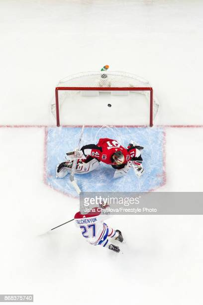 Alex Galchenyuk of the Montreal Canadiens shoots the puck past Craig Anderson of the Ottawa Senators in the second period at Canadian Tire Centre on...