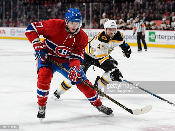 Alex Galchenyuk of the Montreal Canadiens skates against Dennis Seidenberg of the Boston Bruins during the NHL game at the Bell Centre on December 9...