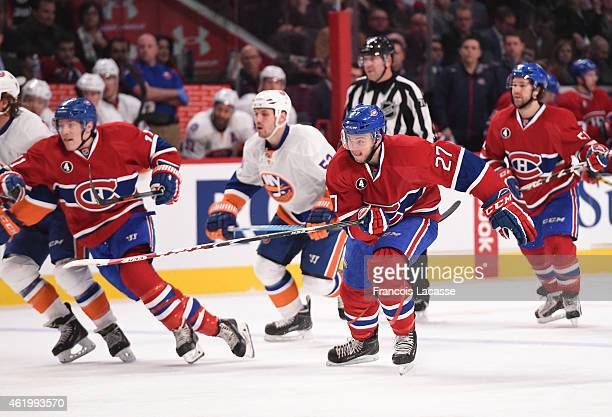Alex Galchenyuk of the Montreal Canadiens skates for position against the New York Islanders in the NHL game at the Bell Centre on January 17 2015 in...