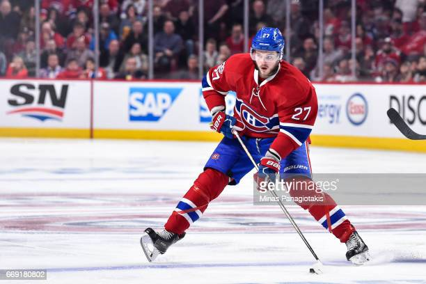 Alex Galchenyuk of the Montreal Canadiens skates the puck across the blue line against the New York Rangers in Game Two of the Eastern Conference...
