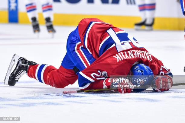 Alex Galchenyuk of the Montreal Canadiens stretches in the warmup prior to Game One of the Eastern Conference First Round during the 2017 NHL Stanley...