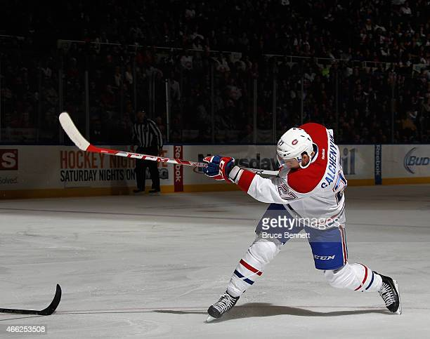 Alex Galchenyuk of the Montreal Canadiens takes the first period shot against the New York Islanders at the Nassau Veterans Memorial Coliseum on...