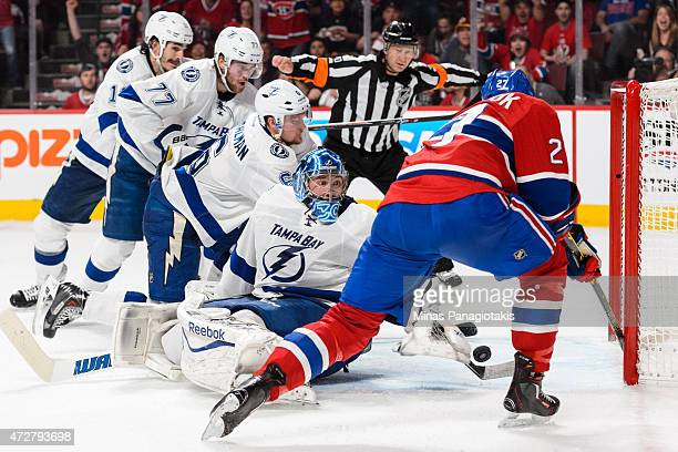 Alex Galchenyuk of the Montreal Canadiens tries to get the puck past goaltender Ben Bishop of the Tampa Bay Lightning in Game Five of the Eastern...
