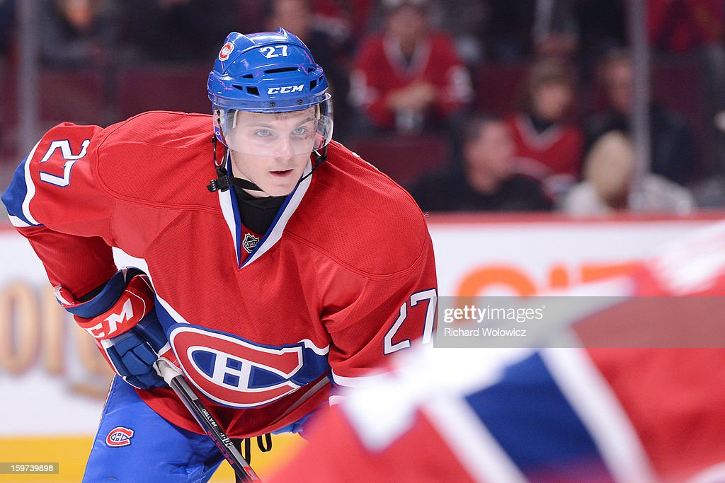 <a gi-track='captionPersonalityLinkClicked' href=/galleries/search?phrase=Alex+Galchenyuk&family=editorial&specificpeople=7419137 ng-click='$event.stopPropagation()'>Alex Galchenyuk</a> #27 of the Montreal Canadiens waits for a face-off during his first career NHL game against the Toronto Maple Leafs at the Bell Centre on January 19, 2013 in Montreal, Quebec, Canada. The Maple Leafs defeated the Canadiens 2-1.