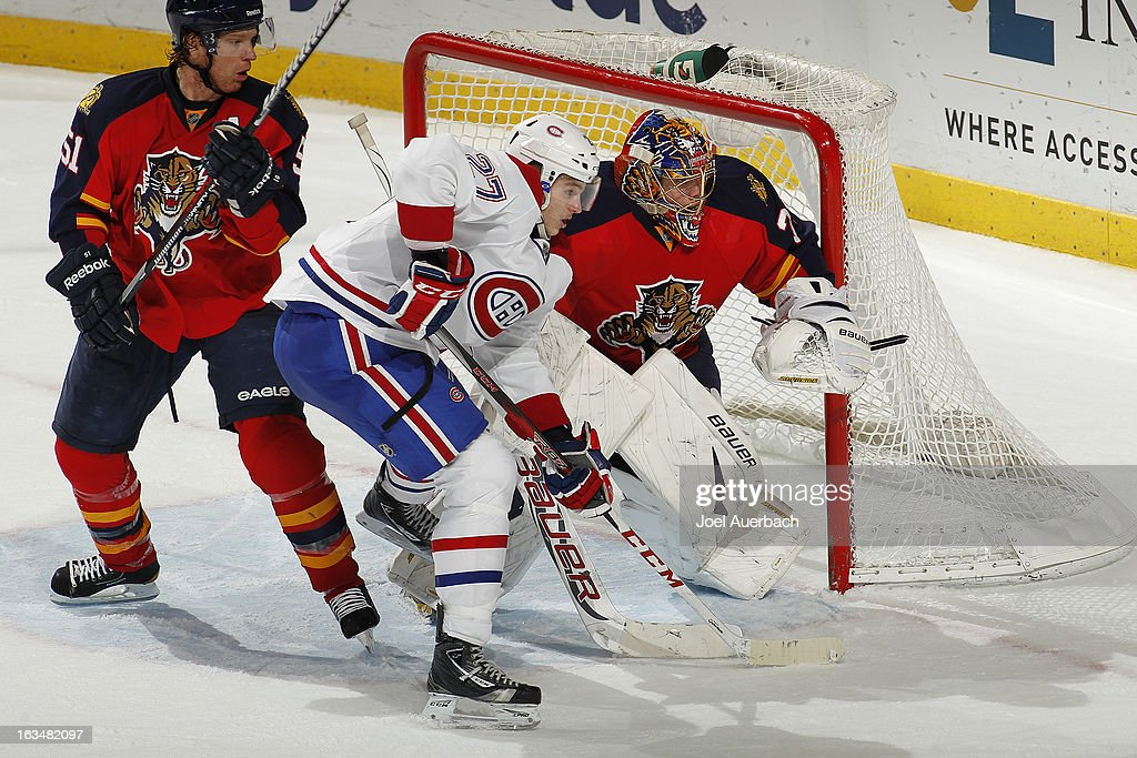 Alex Galchenyuk #27 of the Montreal Canadiens waits for a pass in front of goaltender Jacob Markstrom #35 of the Florida Panthers at the BB&T Center on March 10, 2013 in Sunrise, Florida. The Canadiens defeated the Panthers 5-2.