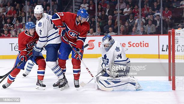 Alex Galchenyuk of the Montreal Canadiens watches the rebounding puck in front of James Reimer of the Toronto Maple Leafs during the NHL game on...