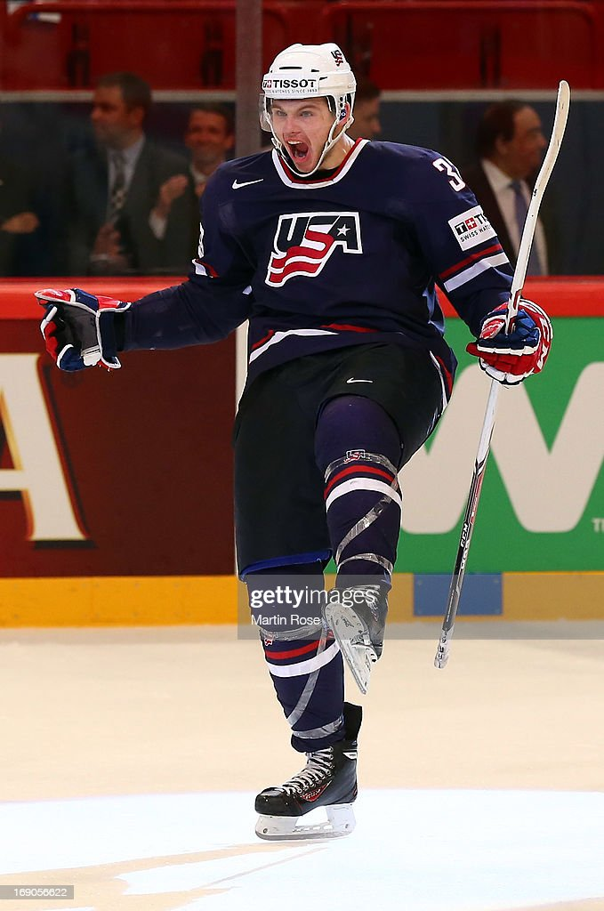 <a gi-track='captionPersonalityLinkClicked' href=/galleries/search?phrase=Alex+Galchenyuk&family=editorial&specificpeople=7419137 ng-click='$event.stopPropagation()'>Alex Galchenyuk</a> of USA celebrates after he scores his team's winning goal during penalty shut out during the IIHF World Championship third place match between Finland and USA at Globen Arena on May 19, 2013 in Stockholm, Sweden.